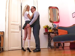 Curly haired blonde in a miniskirt Monique Motherland bends over for a fuck