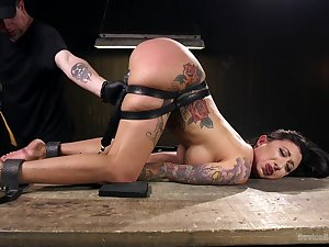 Tattooed hottieLily Lane enjoys hard and kinky sex games with her friend
